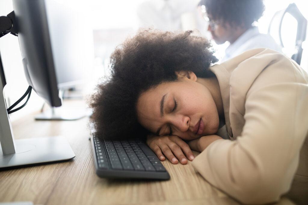 Office worker asleep at desk