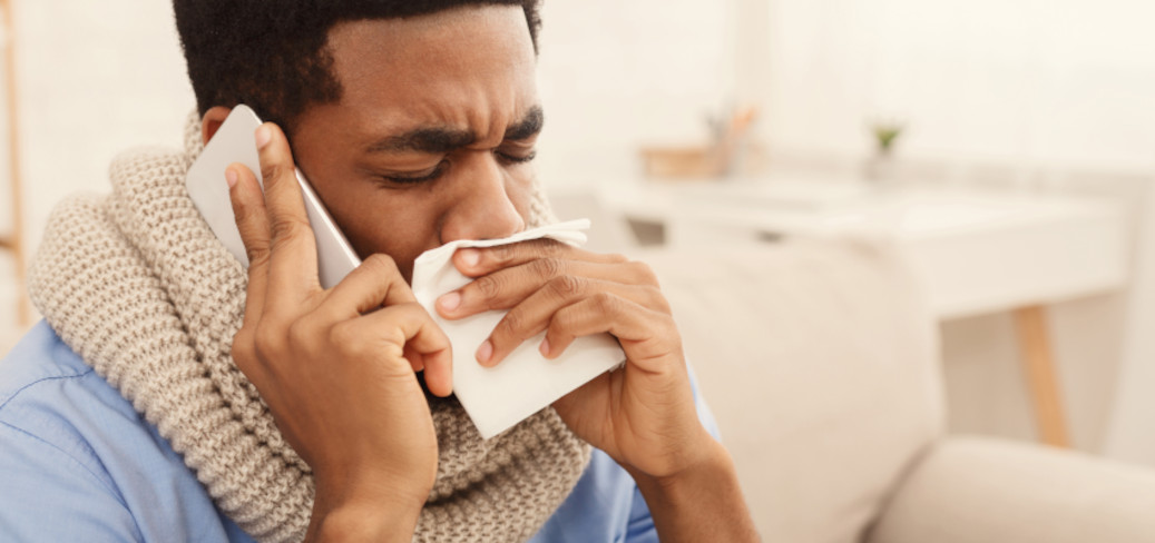 Man calling in sick to work